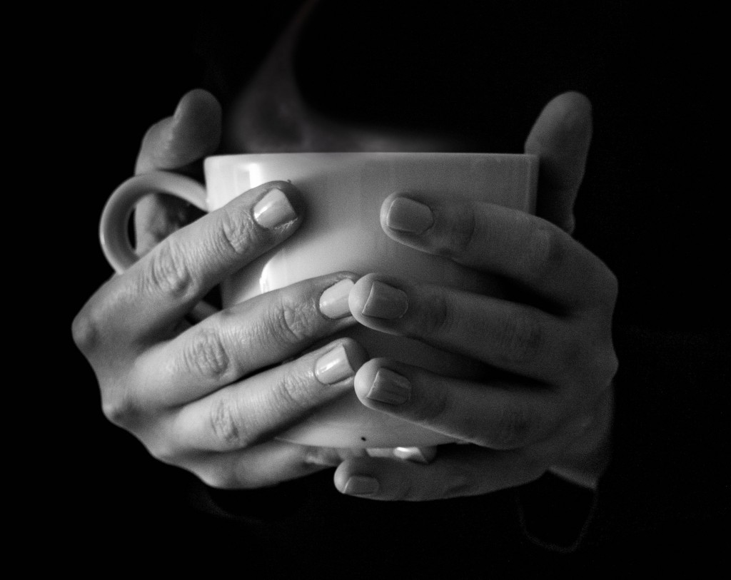 Tea hands holding cup B&W